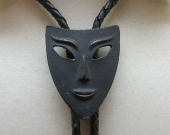Interesting Black Metal Face or Mask Bolo Tie