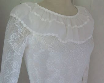 Romantic vintage wedding dress covered with lace