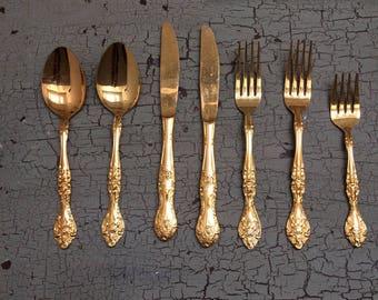Gold tone flatware, seven pieces
