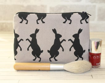 Make-up bag, cosmetics bag, with boxing hares, bunnies, rabbits, woodland fabric