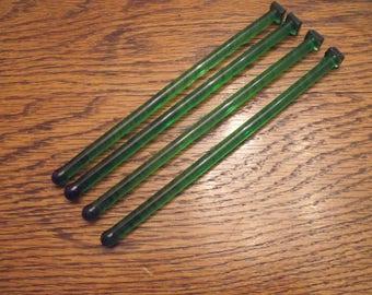 Green glass swizzle sticks