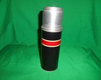 One (1), No. B, 7 1/2 Thermos Vacuum Bottle, with Original Cork Stopper, Circa 1940's.