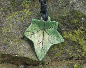 A hand carved sycamore wood from Sherwood forest Ivy pendant with pyrography  detail and cord necklace