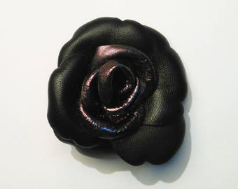 Black lambskin leather and shiny gunmetal heart flower brooch