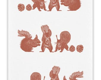 100% cotton tea towel with Three Squirrels and pine cones