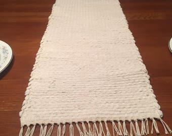 Handwoven table runner in off white