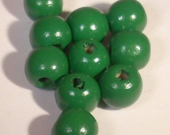 Dark green round wood 12 X 10 mm beads