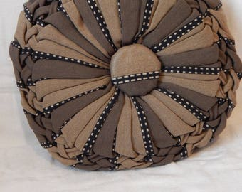 Brown and beige striped woven cushion