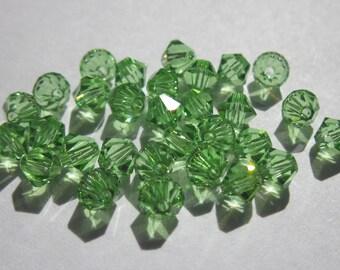 30 genuine swarovski 4mm - peridot (41) Crystal bicones