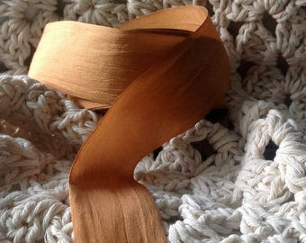 32 yard roll of bronze gold silk ribbon