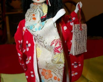 Traditional Geisha doll holding papers from the 1960's Japan