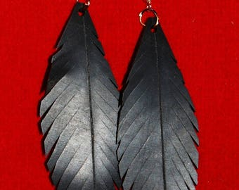 Earrings feather in inner tube