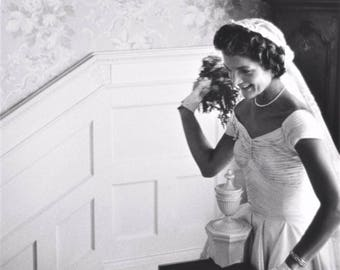 Jacqueline Kennedy prepares to throw her bouquet after being wed to John F. Kennedy on September 12, 1953.