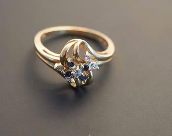 "Yellow 14K Gold ""Diamond & Blue Sapphire"" Swirl Ring - 0.07 Carat Diamonds"