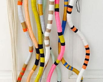 Yarn wrapped wallhanging