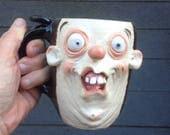 Doofus 14 oz Face Mug with bum on backside. Stoneware. One of a kind. signed J Cotton