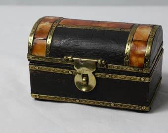 Pirates Chest trinket box, black wood with patterned brass trim and inlay detail