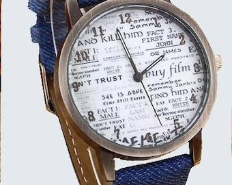 Sporty men's watch in blue jeans ,newspaper.