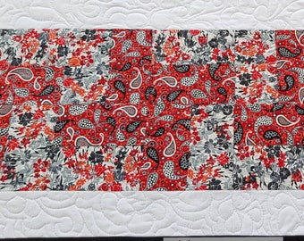 Quilted table runner in black and white and red and grey