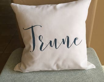 Family name embroidered pillow