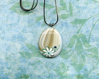 HAND PAINTED PENDANT; hand painted Fused Glass, white daisy, turquoise rhinestone, 28 inch silver metal chain. flat back bail