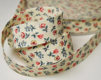 Sewing bias folded 2cm blue background and coral flower pattern cotton cream (by the yard) ref: BIAI03