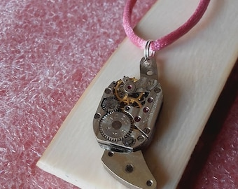 Small vintage watch movement pendant