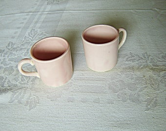 Pair of hand painted pink U.S.A. demitasse mugs near mint condition