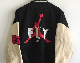 854144d6cf0ce black and yellow jordan varsity jacket cheap   OFF58% Discounted