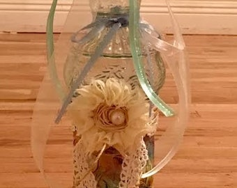 Vintage style decorated teal bottle