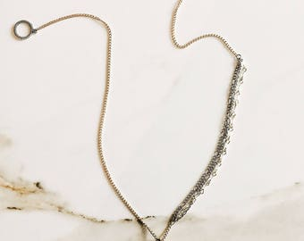 12in long layered metal chain necklace with rose quartz crystal pendant.