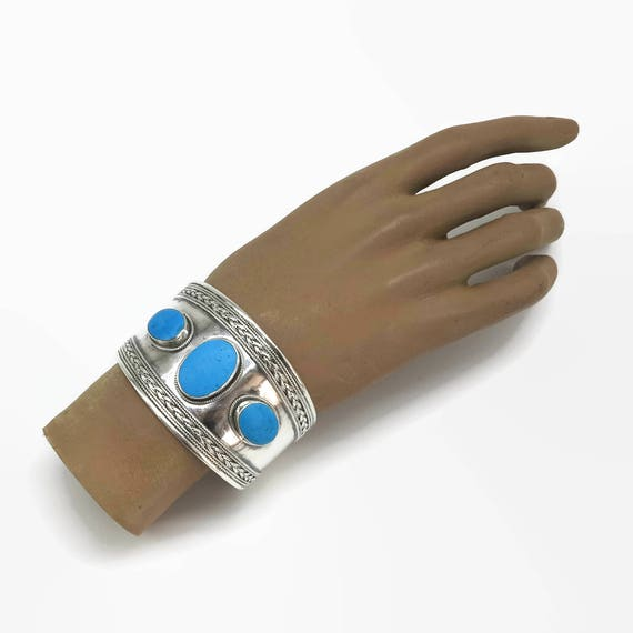 Sterling silver and turquoise cuff bracelet, wide with 3 large turquoise stones and fancy edges, open back, adjustable, 51 gms, circa 1980s