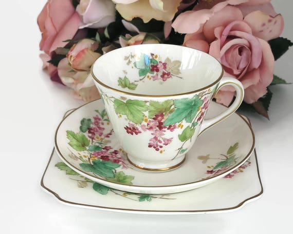 Vintage Royal Doulton cup, saucer, and plate with pattern of pink flowered vine, Gillian pattern, gilt trim, England, circa 1950s