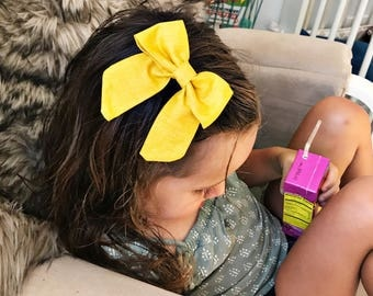 SALE- Textured Mustard  : retro bow on clip