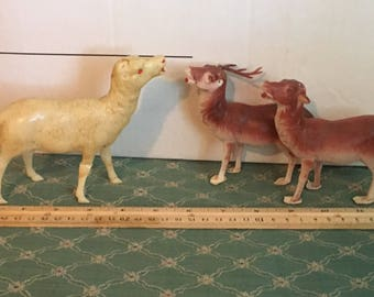 Three antique Christmas reindeer