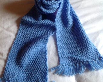 Blue knitted scarf has wheat for children.