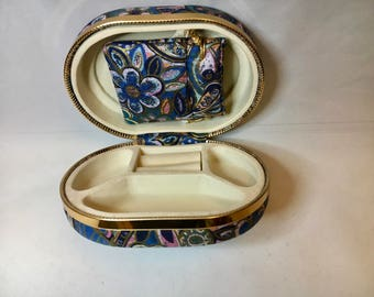 Tapestrylike covered travel jewelry case
