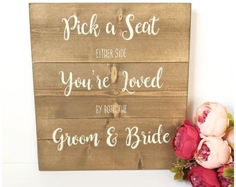 Pick a seat either side you're loved by both the groom and bride - Wedding sign - Wedding ideas - Wedding seating plan - Sign for wedding