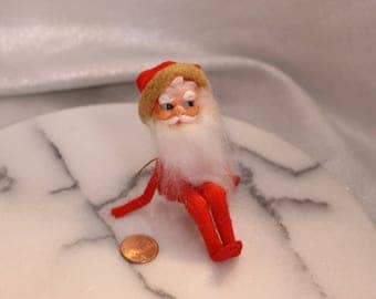 Vintage Collectible Knee Hugging Santa Clause Christmas Decoration White and Red Made in Japan