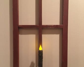 Primitive window with grunge candle and berry garland.  Window. Primitive. Candle. Berry Ring