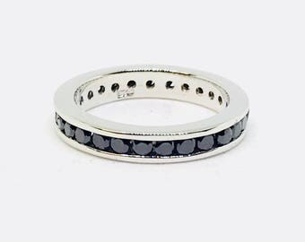 Black Spinel  eternity band ring set in sterling silver (92.5). Size - 5, 6, 7, 8. Natural authentic black spinel. Satisfaction guaranteed .