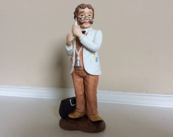 A Lefton China Doctor Figurine with a Hypodermic Needle in His Hand, MLG #00638 G.Z.L.