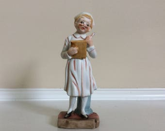 A Nurse with a Chart and Pen in Her Hands Figurine, Original Arnart Creations #44/073.