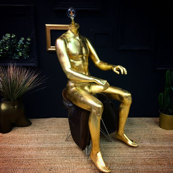 Gold male sitting mannequin lamp