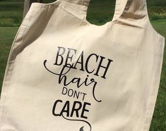 Beach Hair Don't Care tote bag. This stylish canvas bag will hold all your beach essentials!