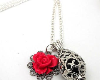 A scent! Necklace has perfume silver red flower
