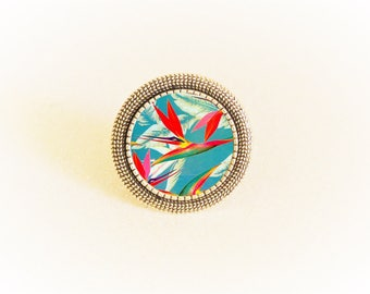 Adjustable silver ring and cabochon red and green tropical flower pattern