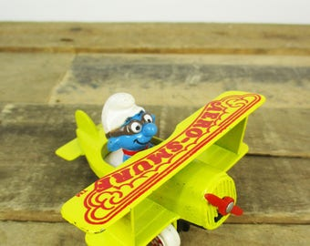 1982 AERO-SMURF Figurine - Awesome Early 1980s Toy, a Smurf Flying a Bright Yellow Propeller Plane.