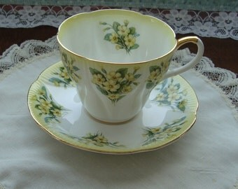 "Royal Albert Dainty Dina Series ""Prudence"" - Bone China England - Vintage Tea Cup and Saucer - Shelley Shape with Yellow Flowers and Trim"