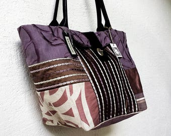 TOTE bag in designer/a fabric blend, its leather